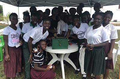 Young Entrepreneurs Club, Liberia 2018, Children round the box containing the money they raised